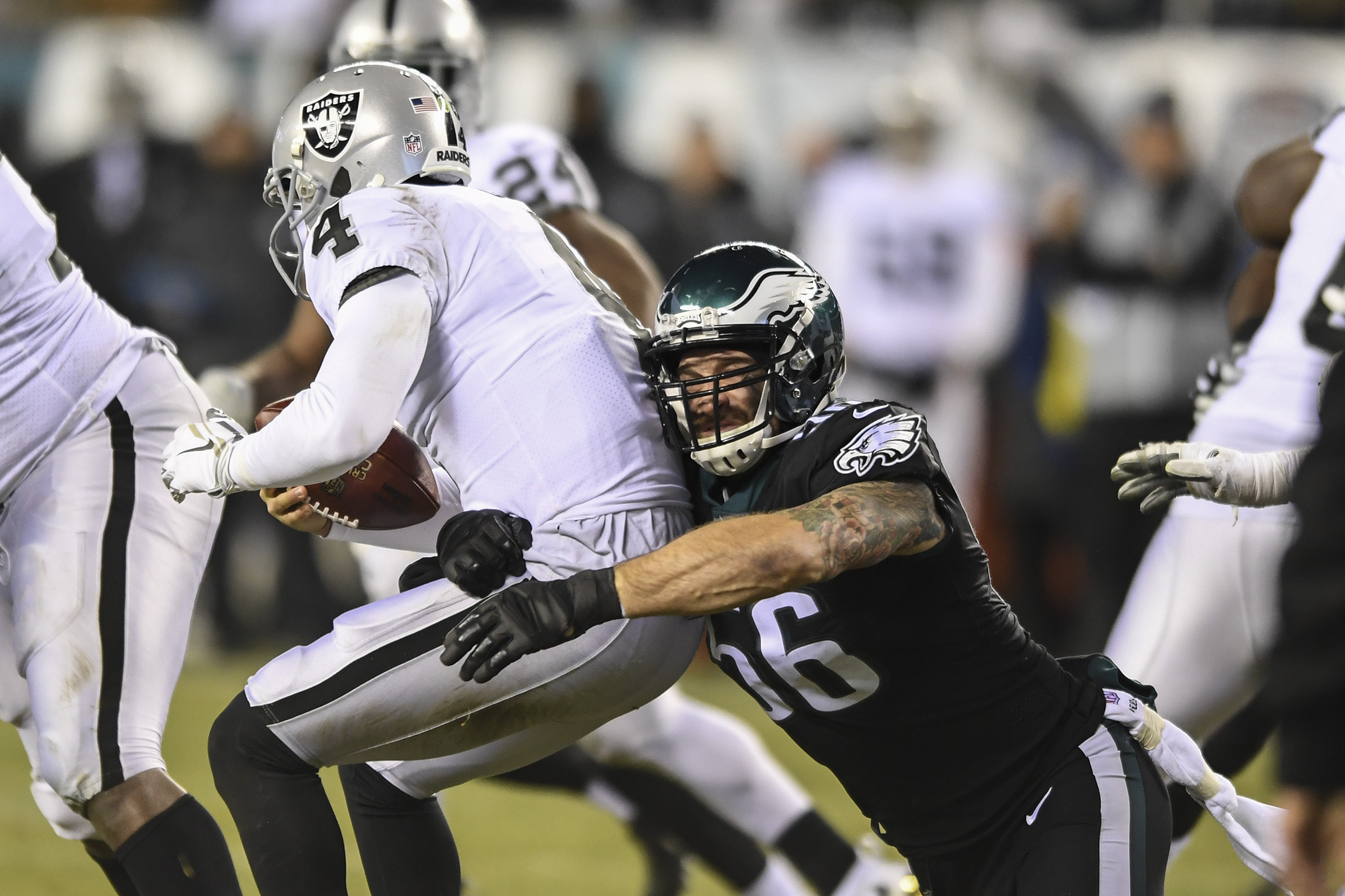 In a play negated by a penalty, Eagles defensive end Chris Long sacks Raiders quarterback Derek Carr.
