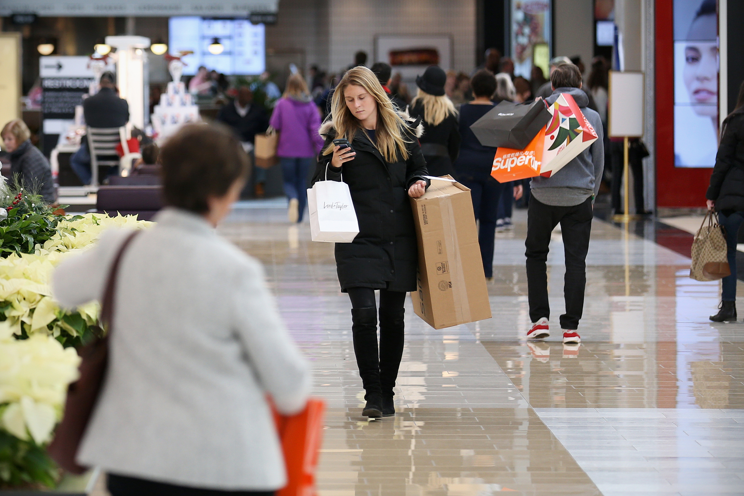 Christmas shoppers made their way through King of Prussia Mall on Thursday, Dec 21, 2017 Many loaded up on winter apparel, like coats, gloves and scarves during the mostly cold and dry holiday shopping season..