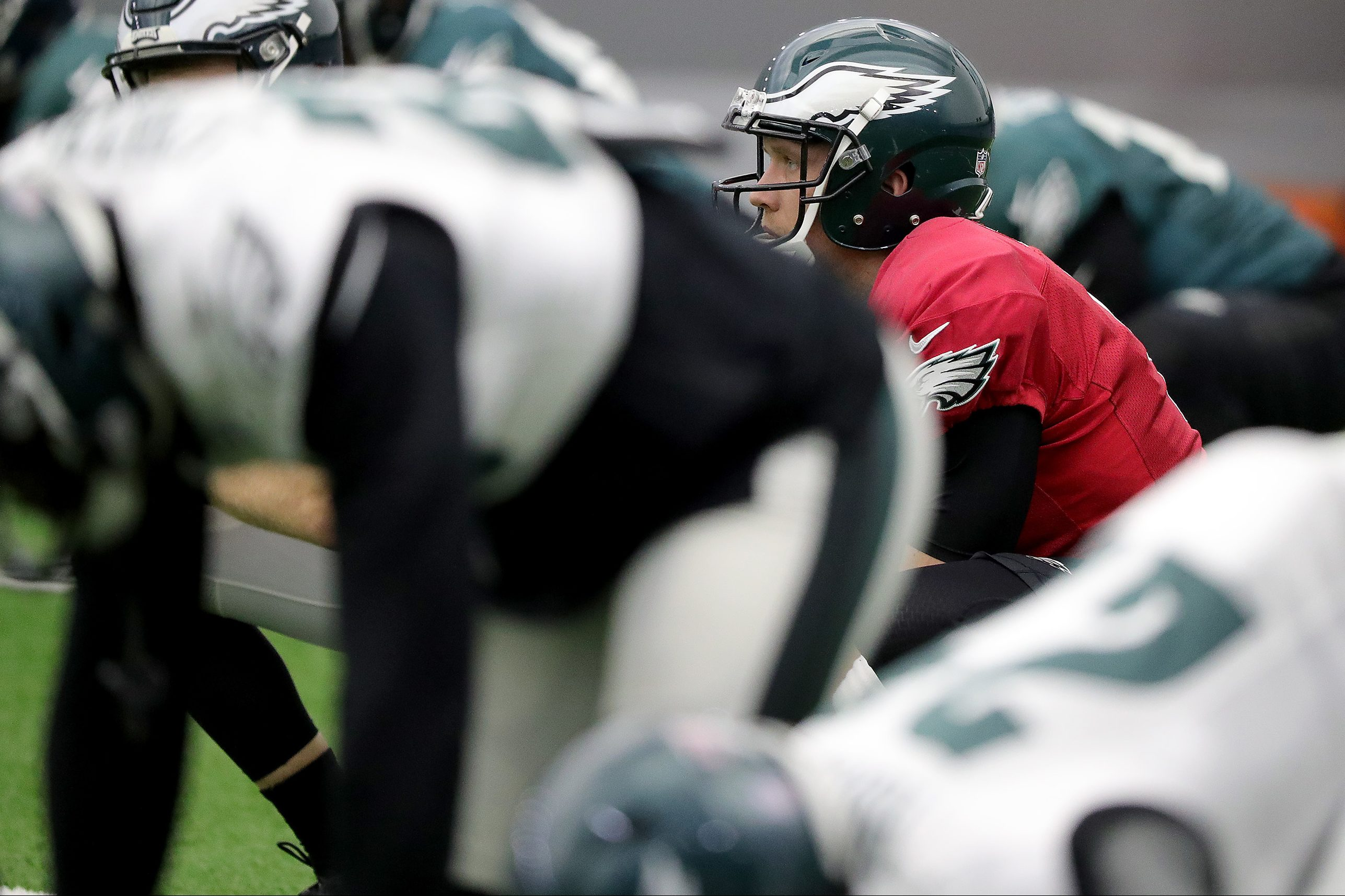 Eagles' Nick Foles, right, warms up as the Philadelphia Eagles practice during the bye week in Philadelphia, PA on January 3, 2018. The Eagles will host a playoff game on Saturday, January 13.