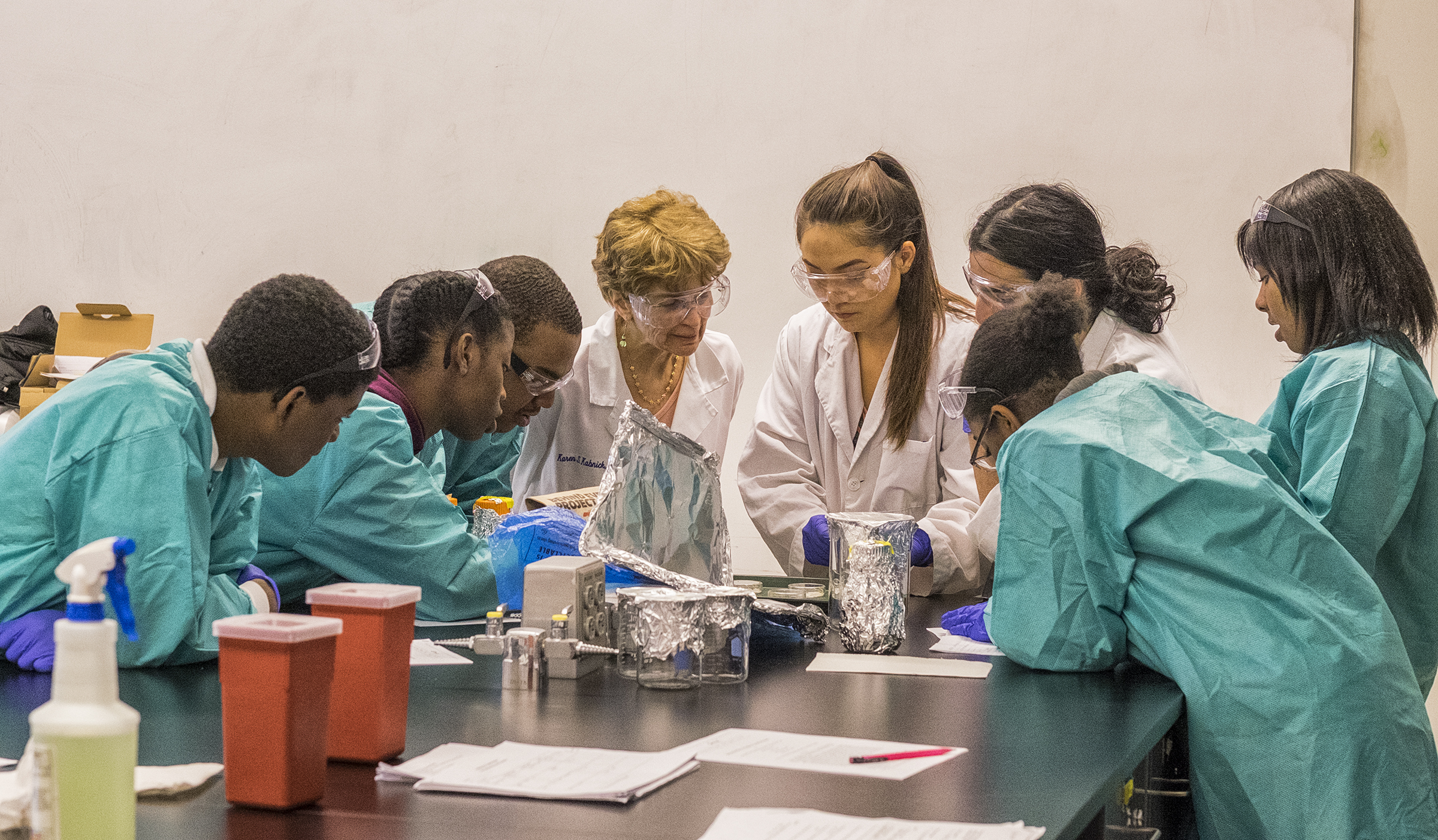 Robeson High has forged partnerships across the city. Here, a group of Robeson students work on an experiment in a Drexel University lab with the help of Drexel faculty and undergraduates.