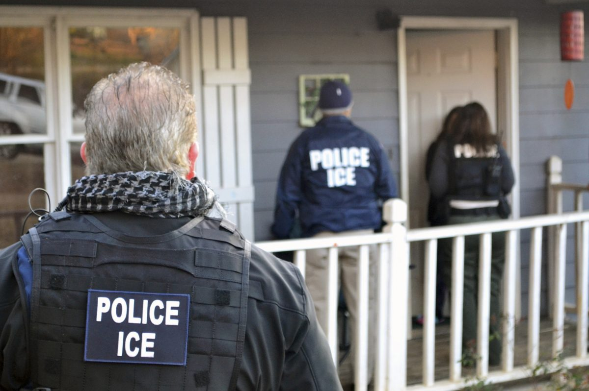 U.S. Immigration and Customs Enforcement agents at a home in Atlanta  during a targeted enforcement operation in 2017.