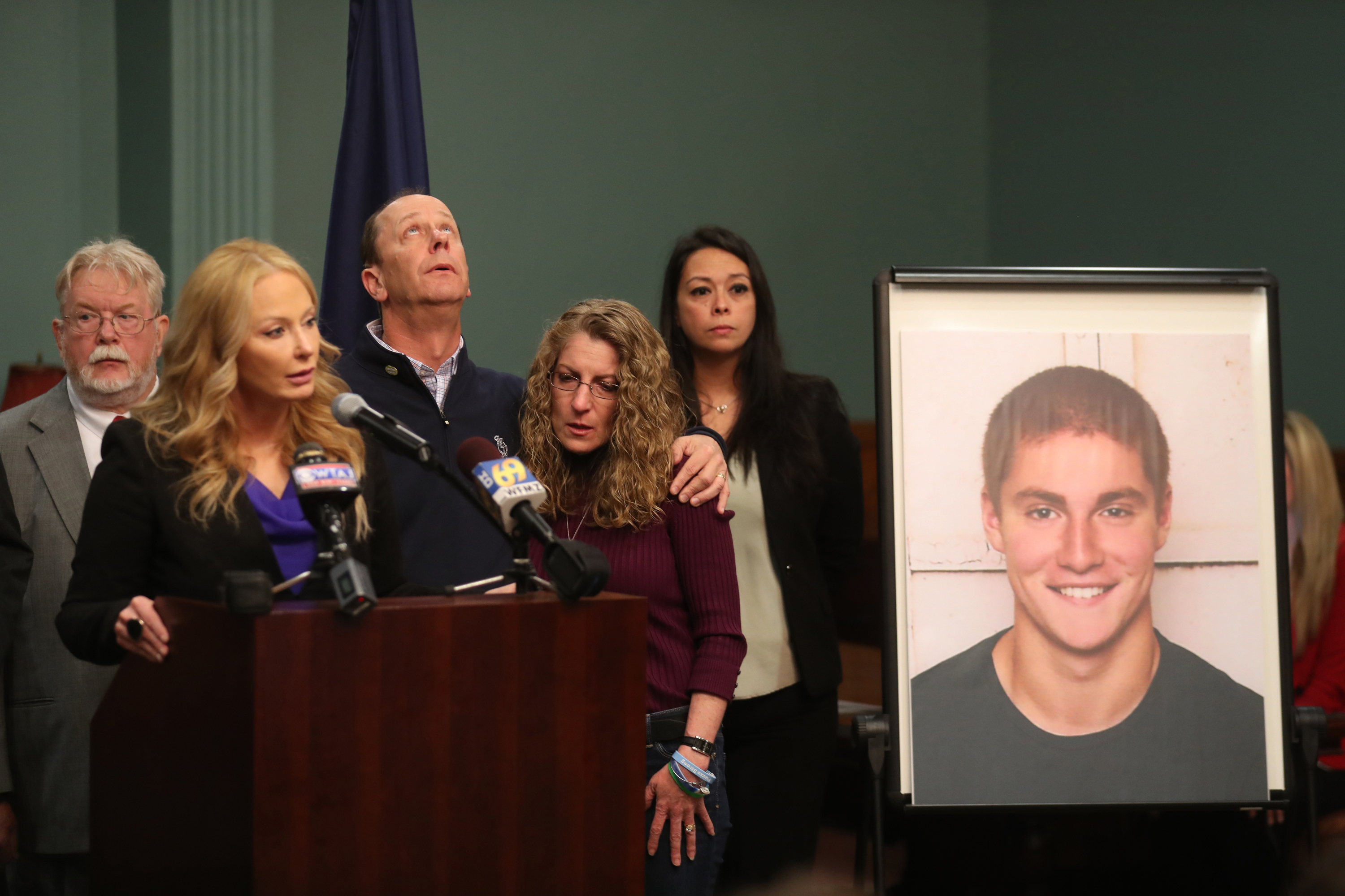 Centre County DA Stacy Parks Miller speaks about the Beta Theta Pi hazing investigation at Penn State University and the charges brought against 18 people. Timothy Piazza´a parents Jim and Evelyn Piazza stand with her in the Centre County Court annex in Bellefonte, Pa., Friday May 5, 2017. ( DAVID SWANSON / Staff Photographer ) ( AP Photo / The Philadelphia Inquirer, David Swanson )