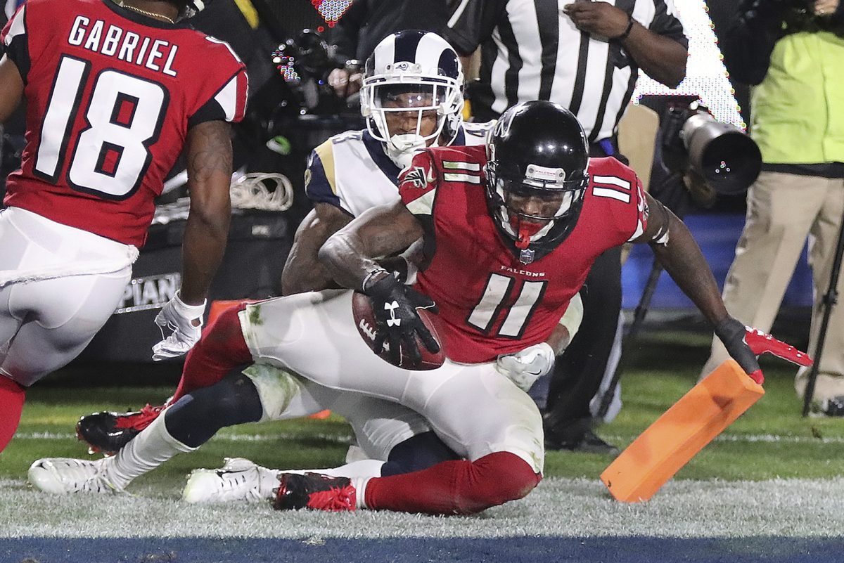 Atlanta wide receiver Julio Jones catches a touchdown pass against the Rams during Saturday's upset win at Los Angeles.  (Curtis Compton/Atlanta Journal-Constitution via AP)