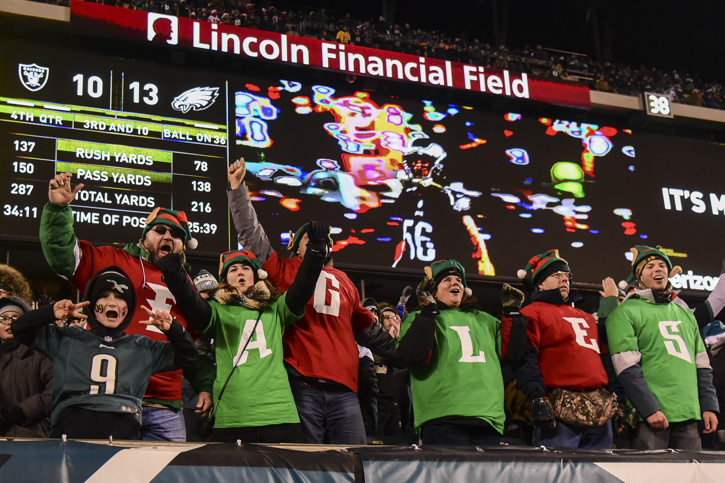 Eagles fans celebrate a play in the game against the Oakland Raider at Lincoln Financial Field in a Monday Night Football game Christmas night 2017. Eagles won 19-10. CLEM MURRAY / Staff Photographer