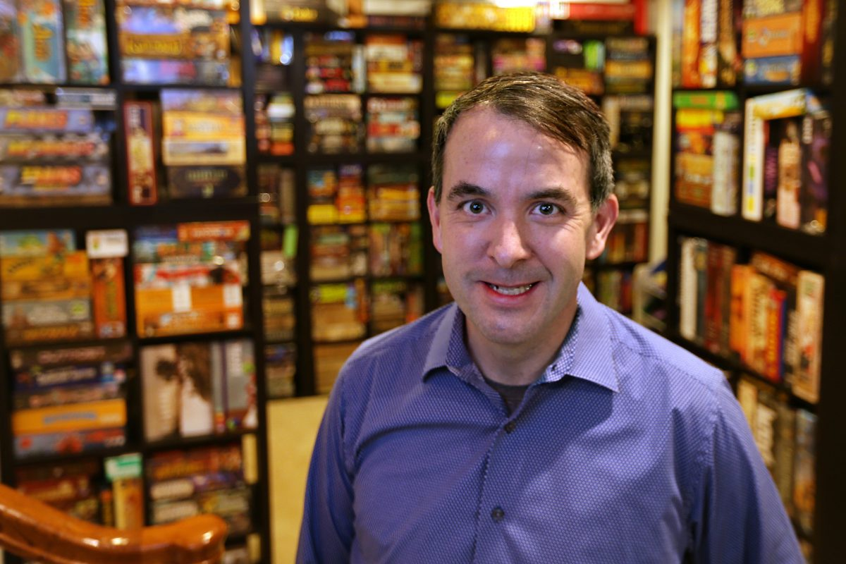 Matt Hendricks, who is opening Thirsty Dice, a board-game cafe, at home in Montgomery County with his massive collection of games.