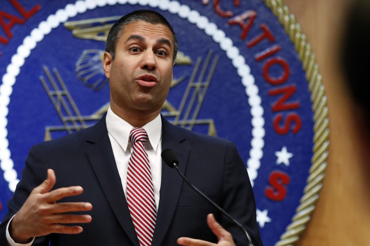 FCC Chairman Ajit Pai answers a question from a reporter.