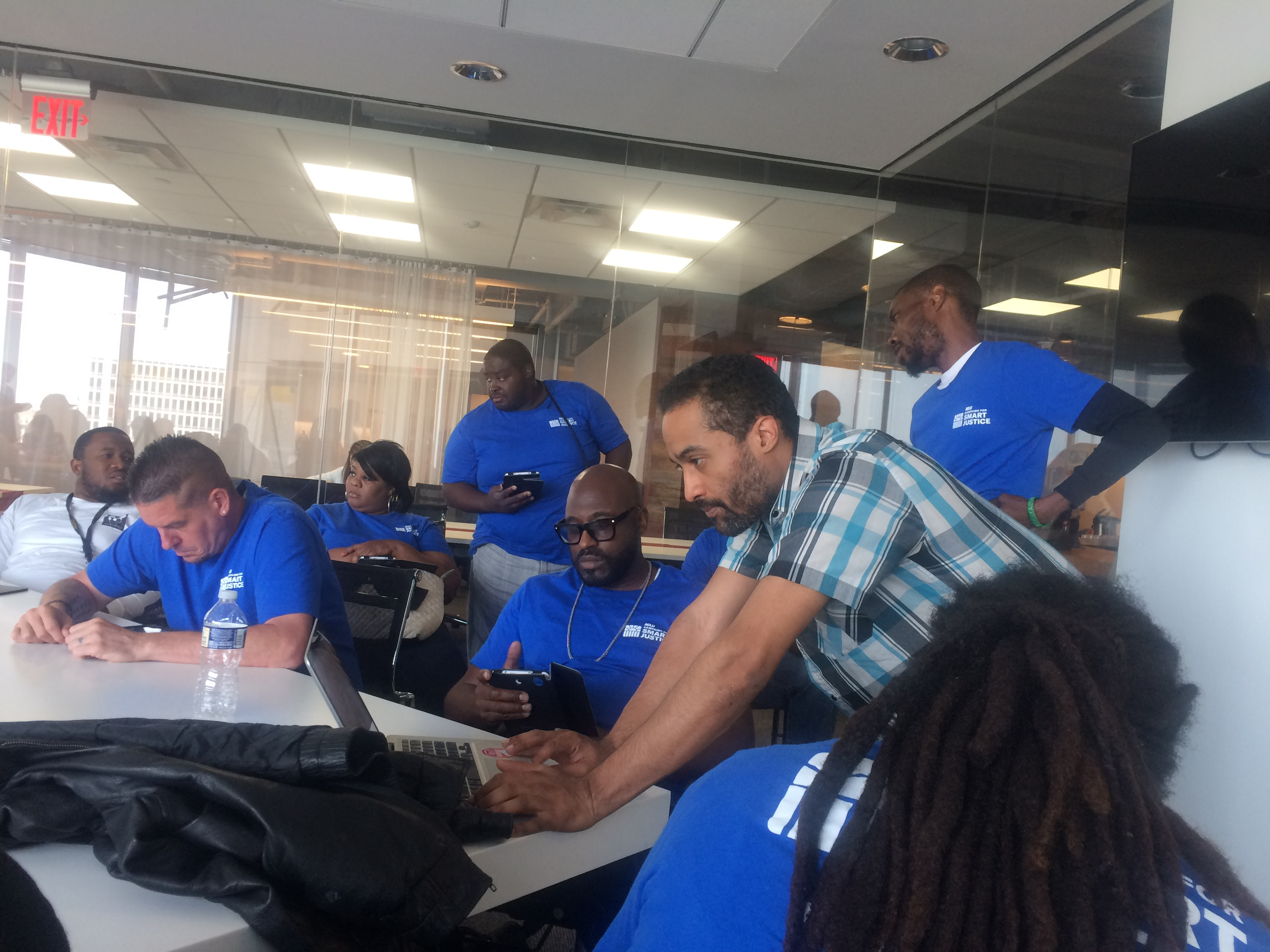 Nick Pressley (right), campaign manager for the ACLU Campaign for Smart Justice, gives out assignments to canvassers, mostly referred by reentry organizations, to do voter education and get-out-the-vote work ahead of the Philadelphia District Attorney race.