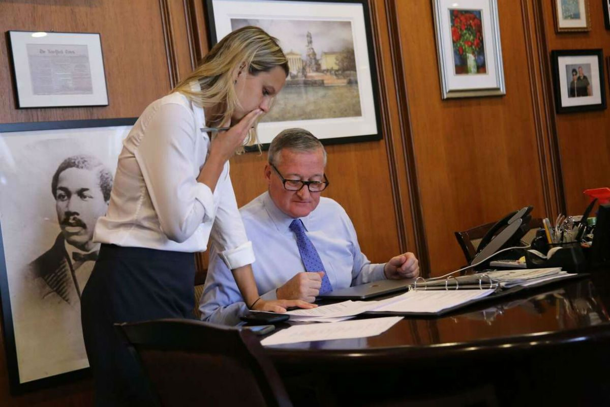 Mayor Kenney and Lauren Hitt, his director of communications, talk in his office at City Hall. Hitt is leaving the administration after two years to work on the congressional campaign of Democrat Randy Bryce, who is challenging Speaker of the House Paul Ryan.