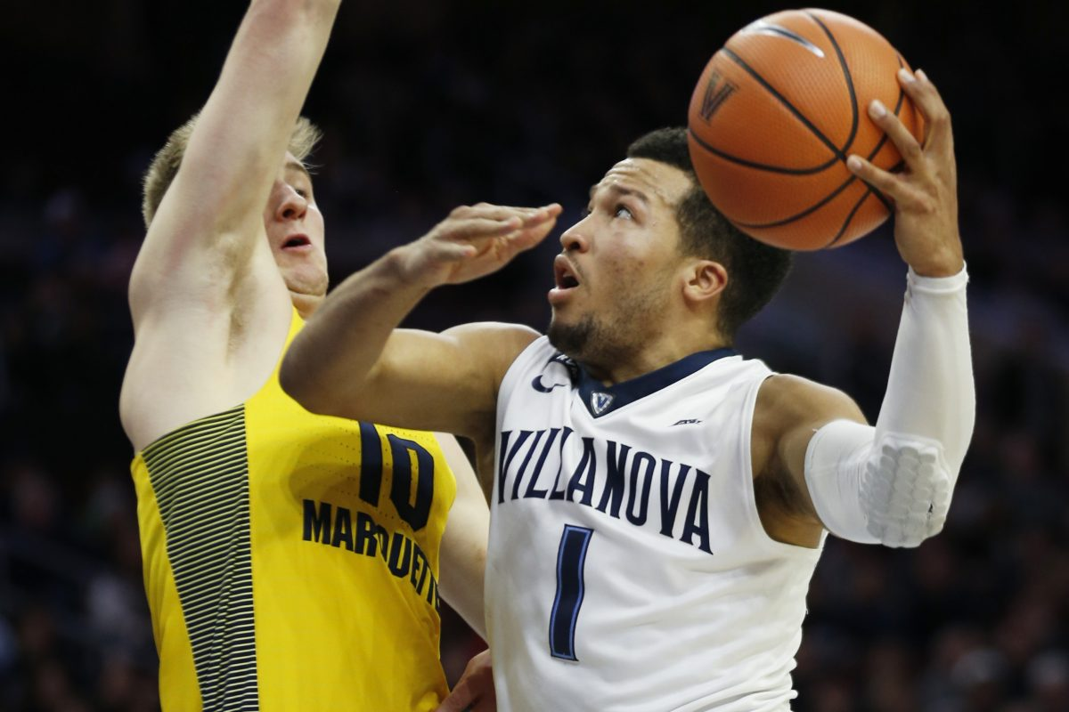 Villanova guard Jalen Brunson (1) goes to the basket as Marquette guard Sam Hauser (10) defends.