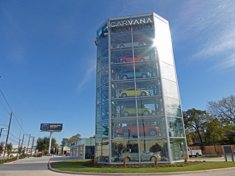 Morris + Associates helped design the glass car tower for Carvana´s Houston location.
