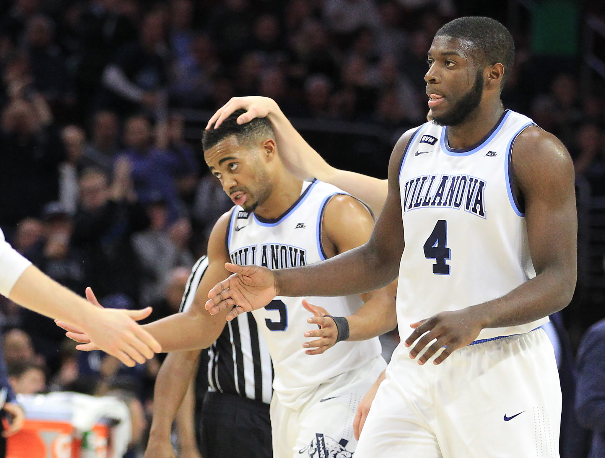 Phil Booth, left, and Eric Paschall of Villanova are congratulated during a timeout as Villanove defeated Xavier 89-65 at the Wells Fargo Center on Jan 10, 2018.