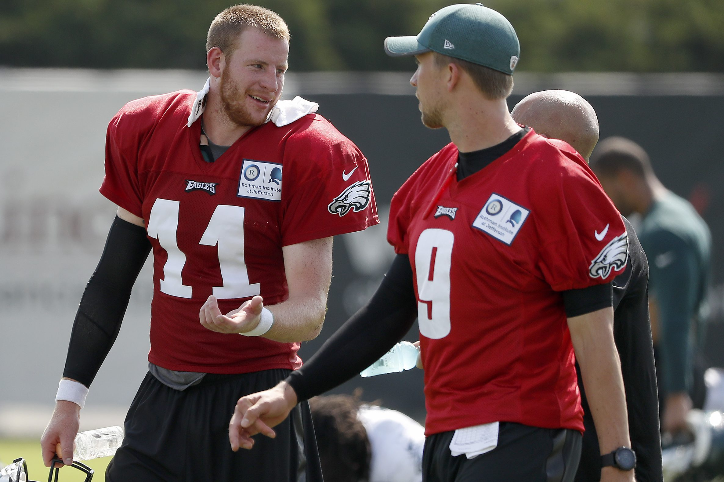 Carson Wentz and Nick Foles,. pictured during training camp. have different cadences, different ways of calling plays
