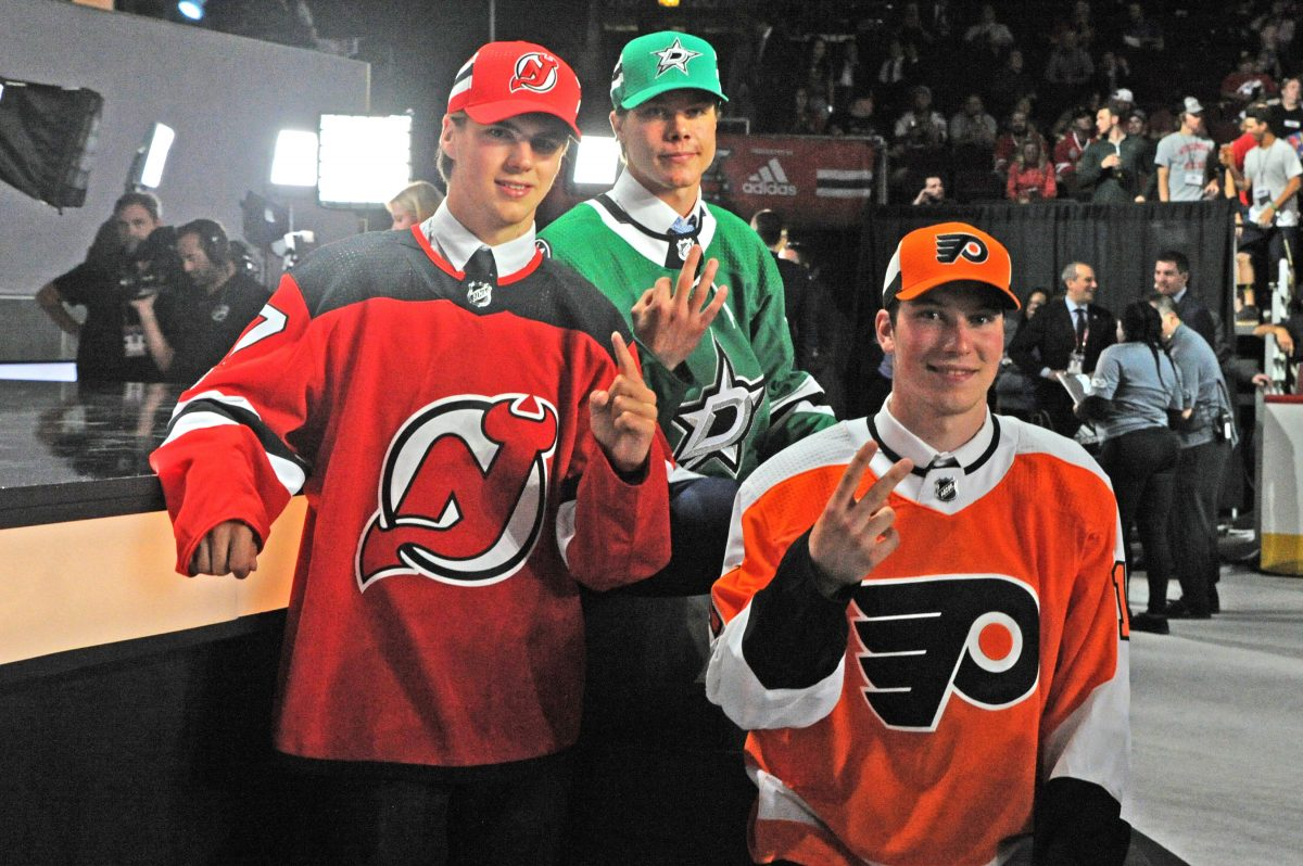 New Jersey Devils center Nico Hischier (left), Flyers center Nolan Patrick (right), and Dallas Stars defenseman Miro Heiskanen (center) pose after being selected in the first round of the 2017 NHL Draft. Patrick Gorski/Icon Sportswire