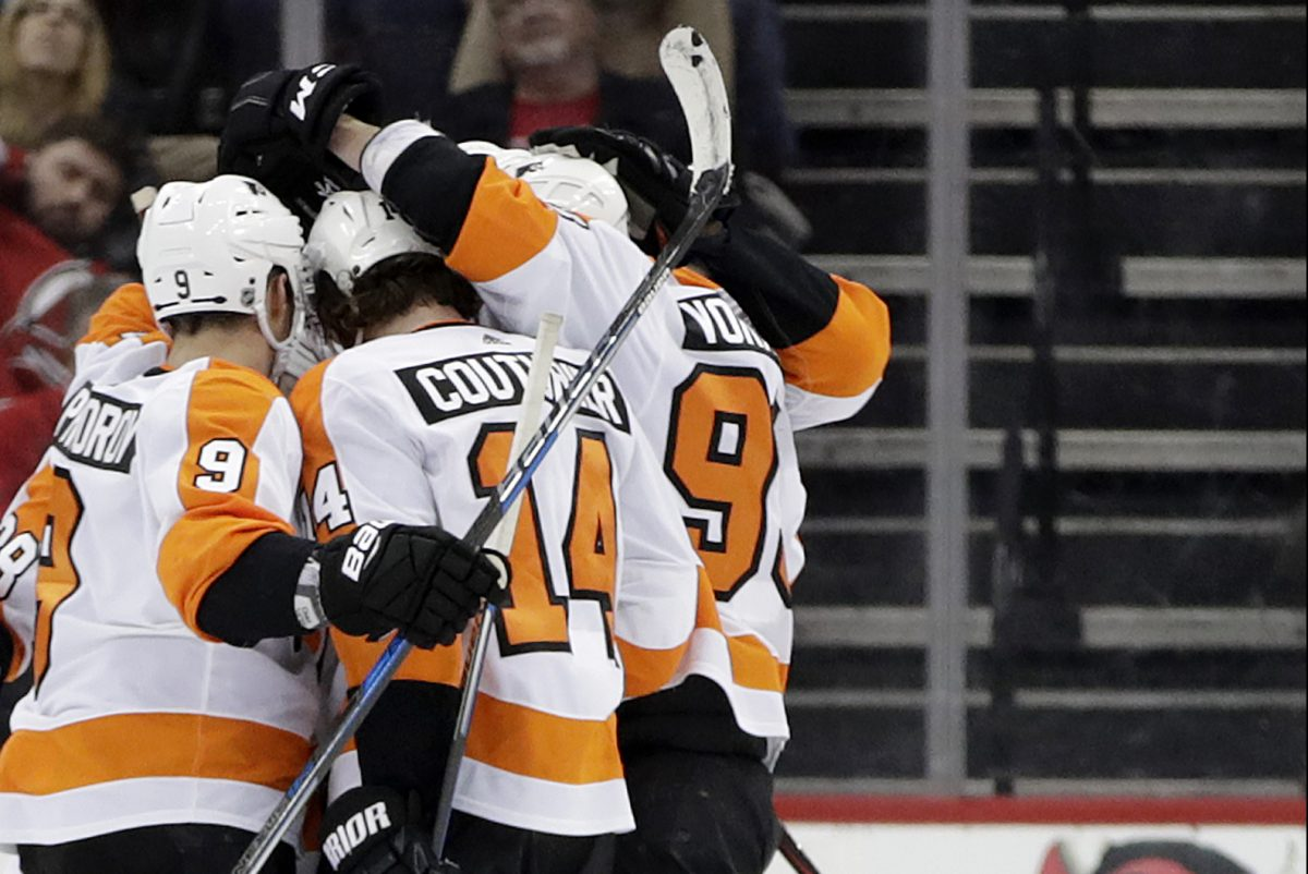 Flyers players celebrating a goal by Sean Couturier (14) against New Jersey on Saturday.
