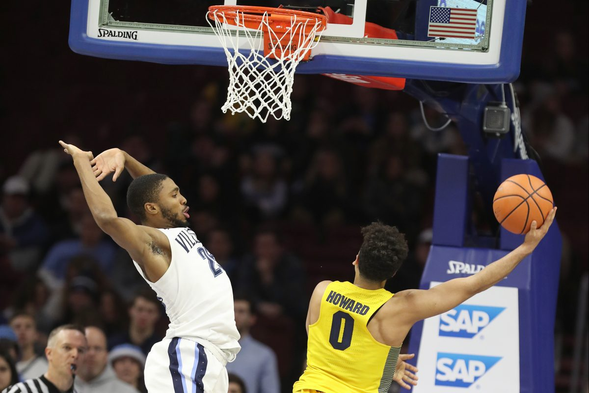 Markus Howard, right, of Marquette scoring two of his 37 points against Villanova on Jan 6.