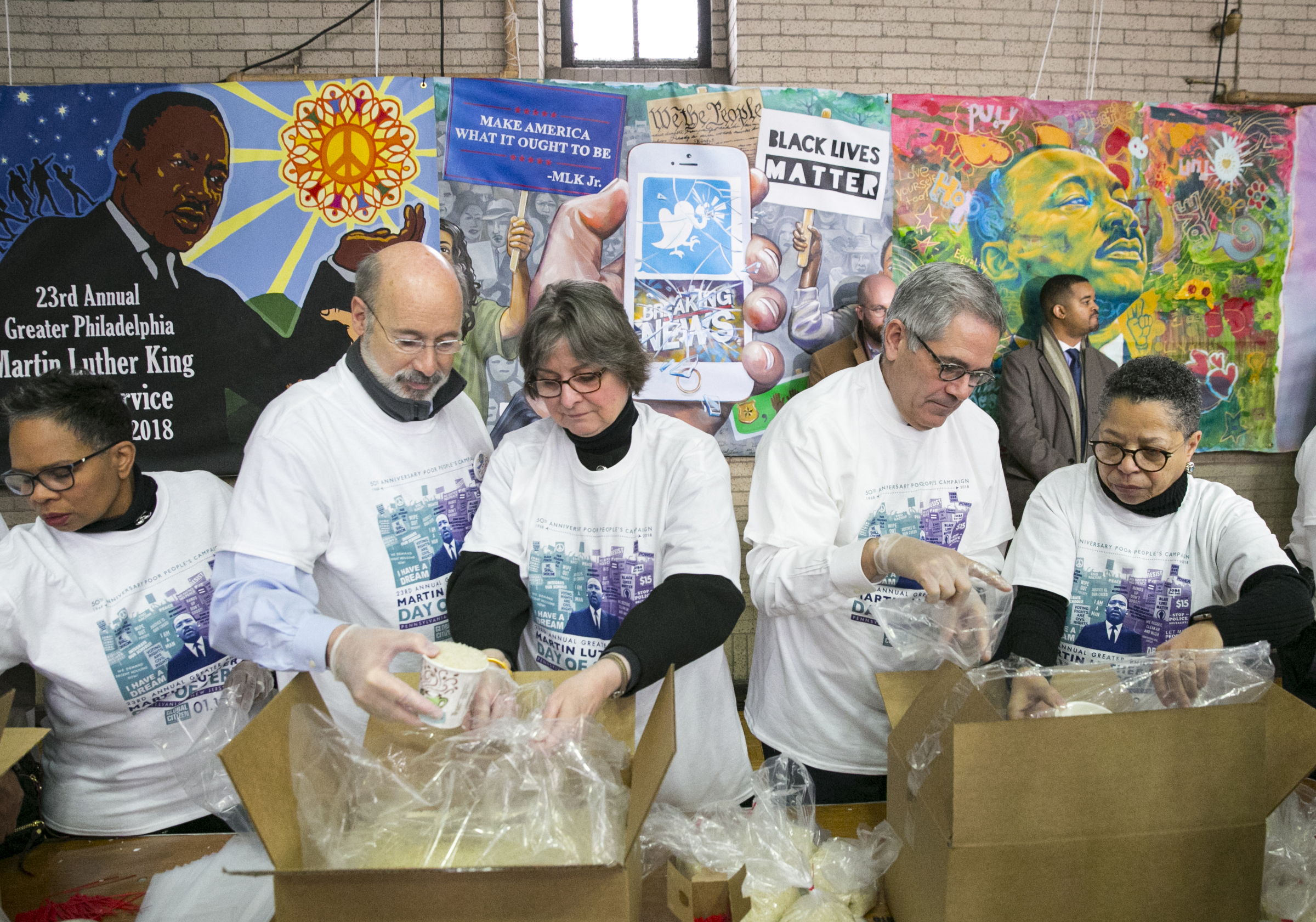 (Left to Right) Ava Willis-Barksdale, President of Girard College, Governor Tom Wolf, Frances Wolf, First Lady of PennsylvaniaVolunteers, Larry Krasner, District Attorney of Philadelphia, and Sharmain Matlock-Turner, President and CEO of the Urban Affairs Coalition, volunteer, portioning out rice, at the MLK Day of Service at Girard College, in Philadelphia, Monday, Jan. 15, 2018. JESSICA GRIFFIN / Staff Photographer