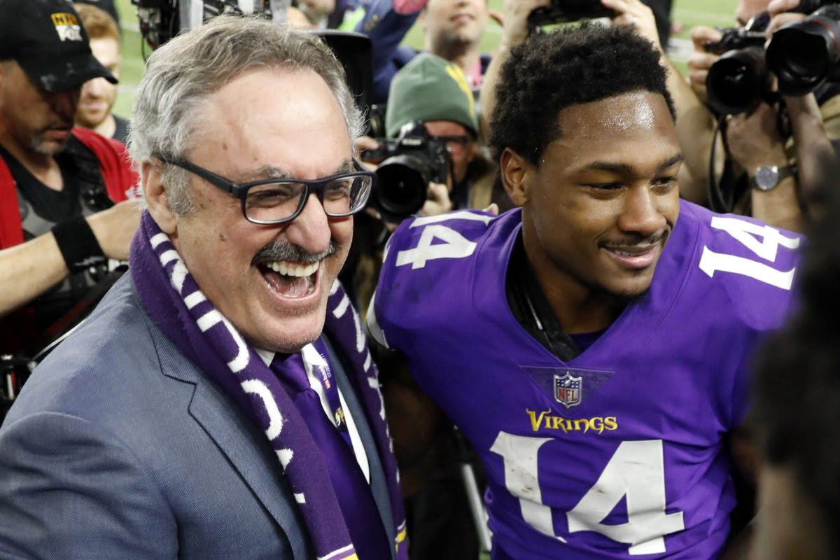 Minnesota Vikings owner Zygi Wilf, left, celebrates with Stefon Diggs (14) following a 29-24 win over the New Orleans Saints in Sunday's NFL divisional  playoff game.