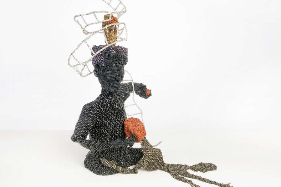 "Joyce J. Scott's ""Buddha Gives Basketball to the Ghetto""; (1991), part of a retrospective at Grounds for Sculpture in Hamilton, N.J. (Collection of Carol Cole Levin)"