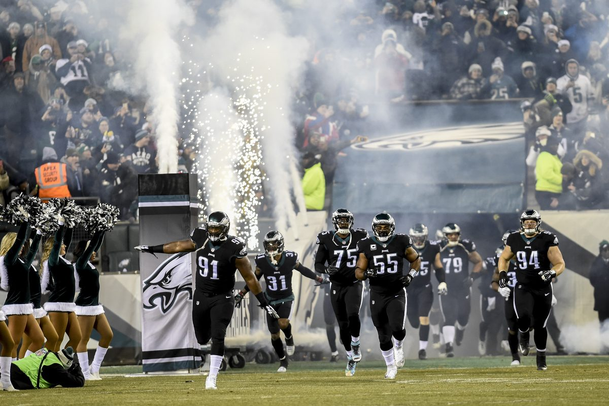 Eagles All-Pro defensive tackle Fletcher Cox (#91) leads his teammates, including (from left) Jalen Mills, Vinny Curry, Brandon Graham and Beau Allen, out onto the field for the game against the Oakland Raiders at Lincoln Financial Field in a Monday Night Football game Christmas night 2017. Eagles won 19-10. CLEM MURRAY / Staff Photographer