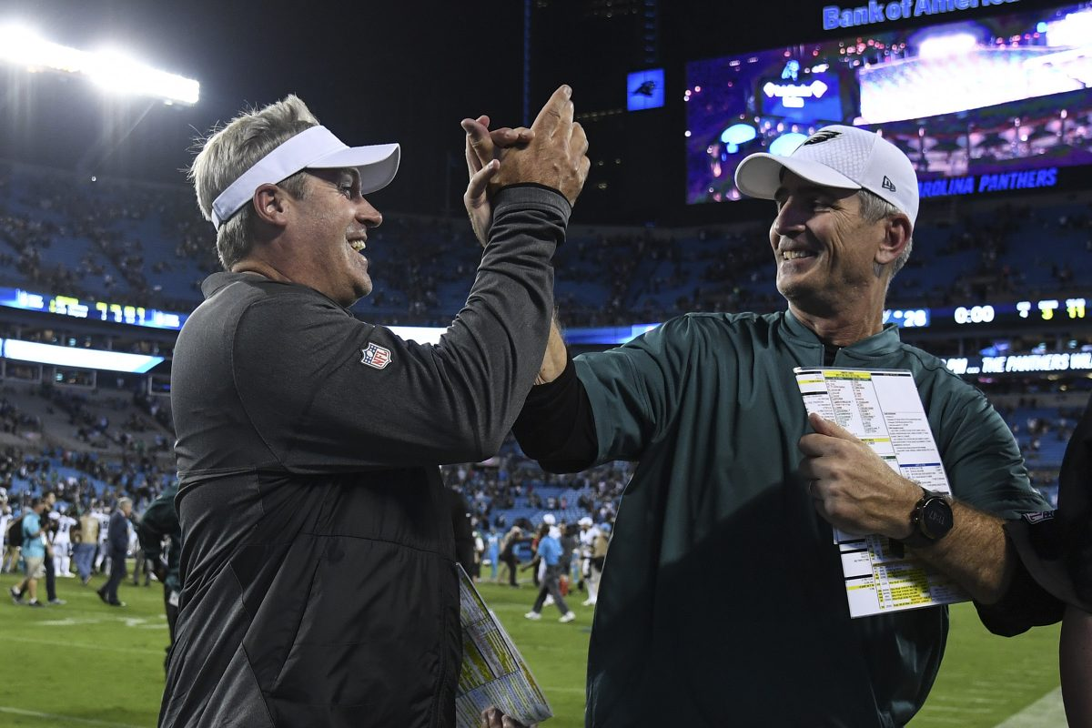 Eagles head coach Doug Pederson (left) and offensive coordinator Frank Reich celebrate the team's win over the Panthers at Bank of America Stadium October 12, 2017. Eagles beat the Panthers 28-23. CLEM MURRAY / Staff Photographer
