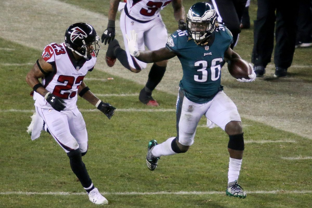 Eagles running back Jay Ajayi fends off Falcons cornerback Robert Alford during the second half of the Eagles' win on Saturday,