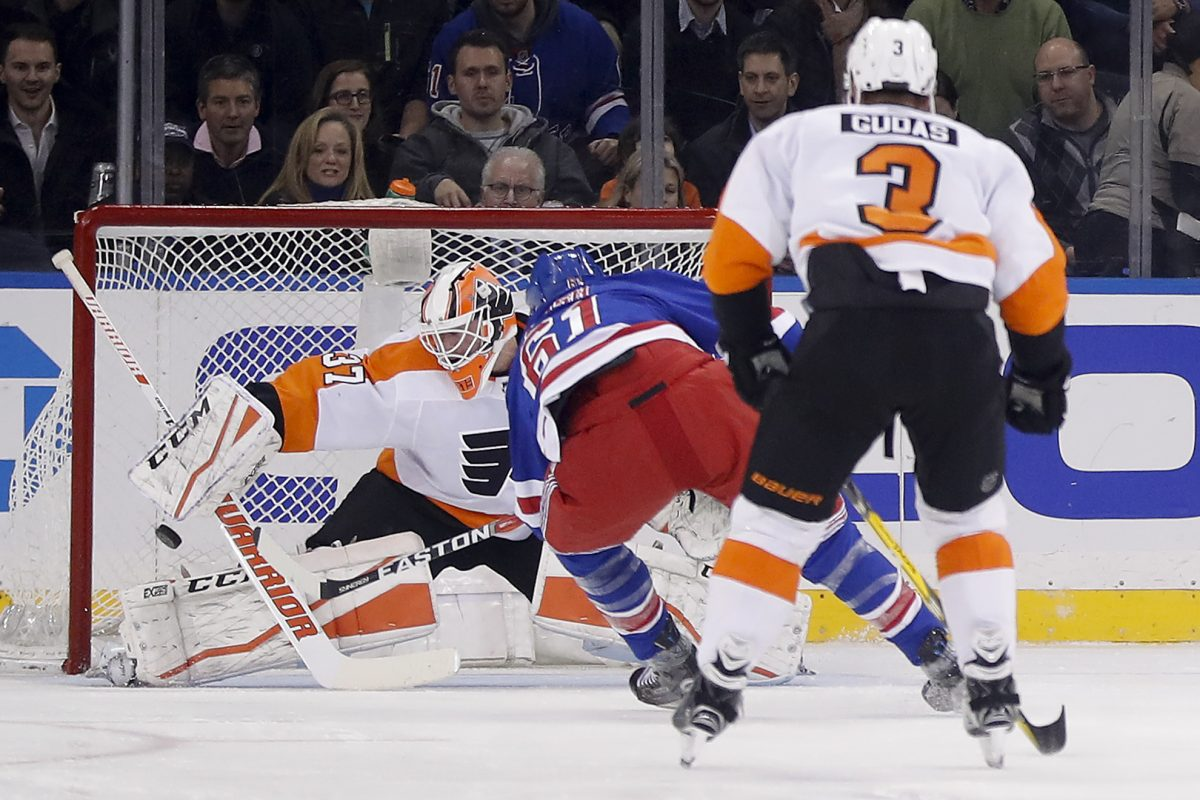 New York Rangers right wing Rick Nash (61) scores a goal against Philadelphia Flyers goaltender Brian Elliott (37) during the first period of an NHL hockey game, Tuesday, Jan. 16, 2018, in New York.