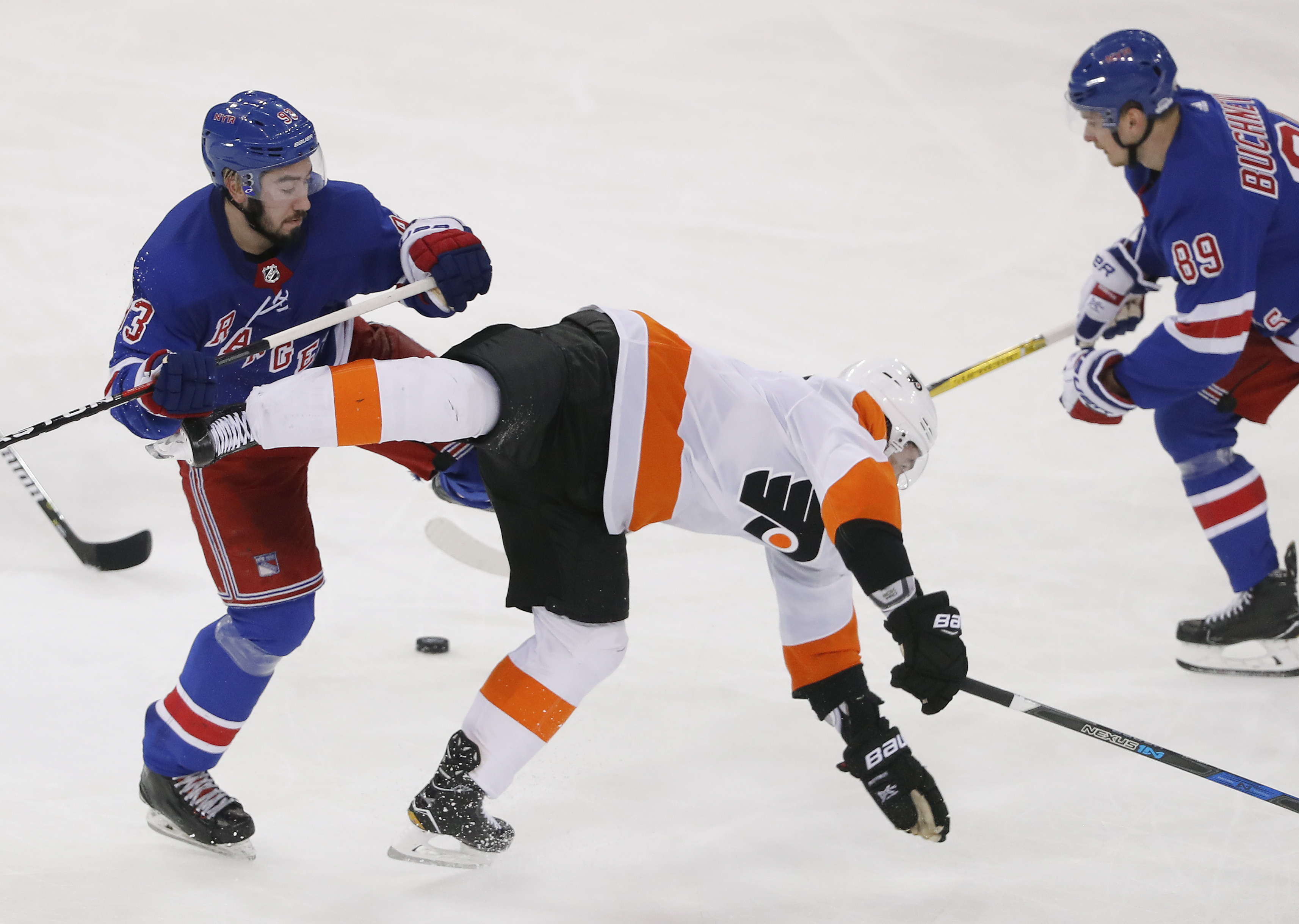 New York Rangers center Mika Zibanejad (93) collides with Philadelphia Flyers defenseman Ivan Provorov (9) during the third period of an NHL hockey game, Tuesday, Jan. 16, 2018, in New York. The Rangers won 5-1.