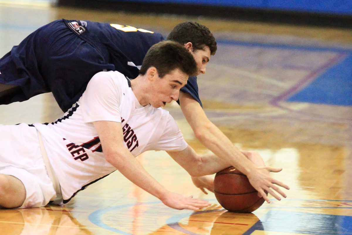 Shane Cohen, top, of Lower Moreland and Jack Elliott of Holy Ghost Prep scramble for a loose ball in the 2nd quarter on Jan 16, 2018.