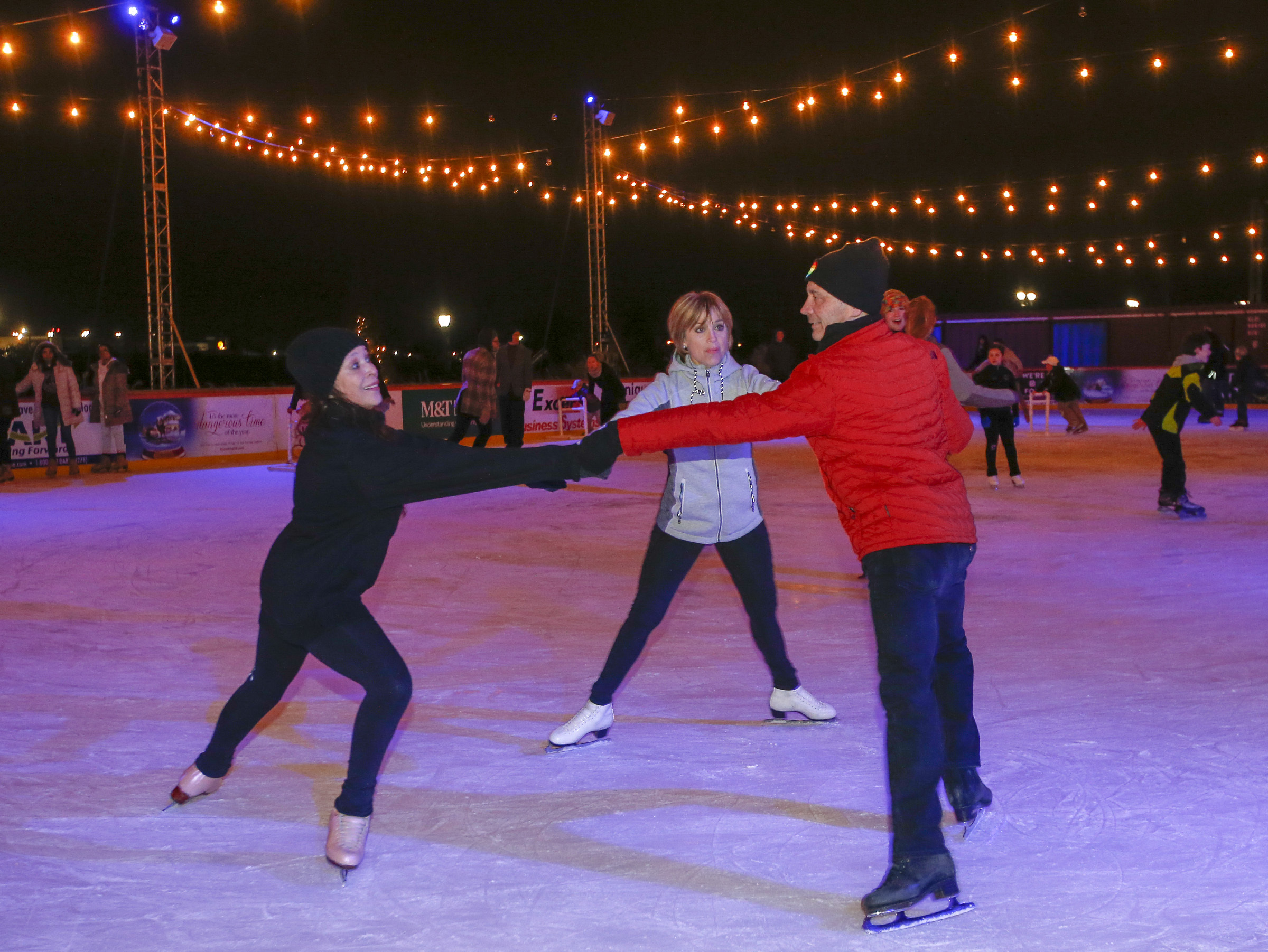 From right: Tai Babilonia, Randy Gardner and Dorothy Hamill skate at Wilmington´s Riverfront Rink.