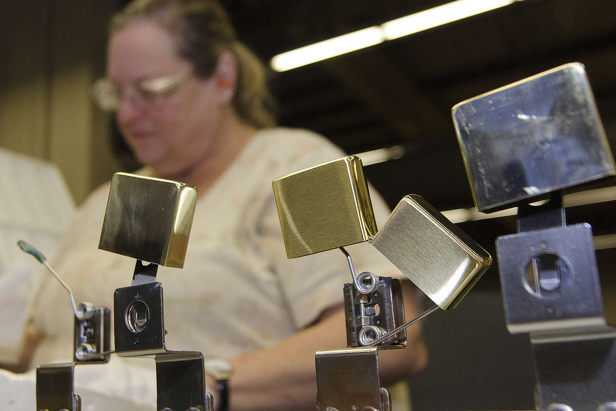 Cheryl Coldrun, Zippo Manufacturing Co. employee, inspects brass lighter cases on the buffing-line at the company´s plant in Bradford, Pennsylvania, Monday, January 15, 2018. Zippo is the top employer in rural McKean County and it´s a company that the whole city of Bradford and the surrounding county revolve around.