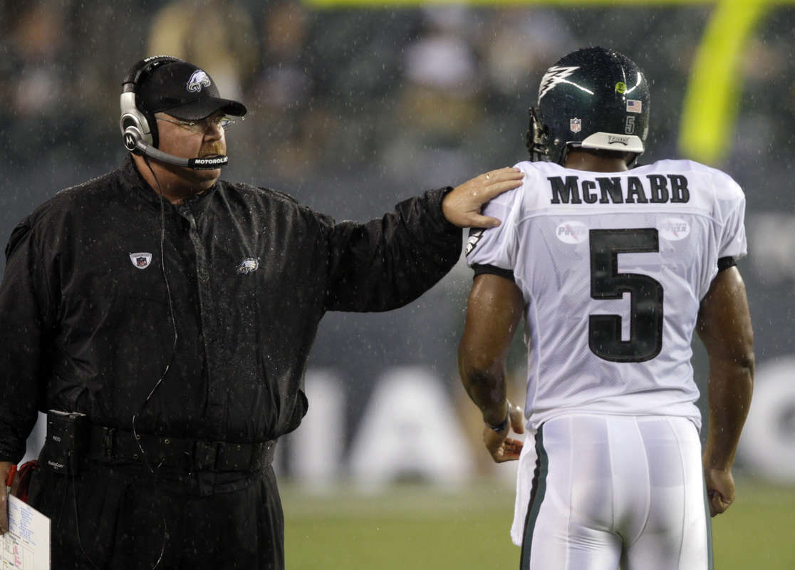 Eagles´ coach Andy Reid taps Donovan McNabb before the Eagles resumed play against the Carolina Panthers in the first qaurter on August 14, 2008.