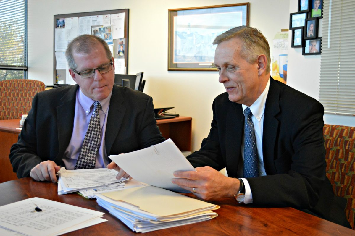 """In the West Chester Area School District, Superintendent Jim Scanlon (right) and Director of Business Affairs John Scully  anticipate a budget increase driven largely by growing fixed costs — a teachers' contract, pension contributions and special education services. """"A lot of it is pretty locked up,"""" Scanlon said of the budget."""