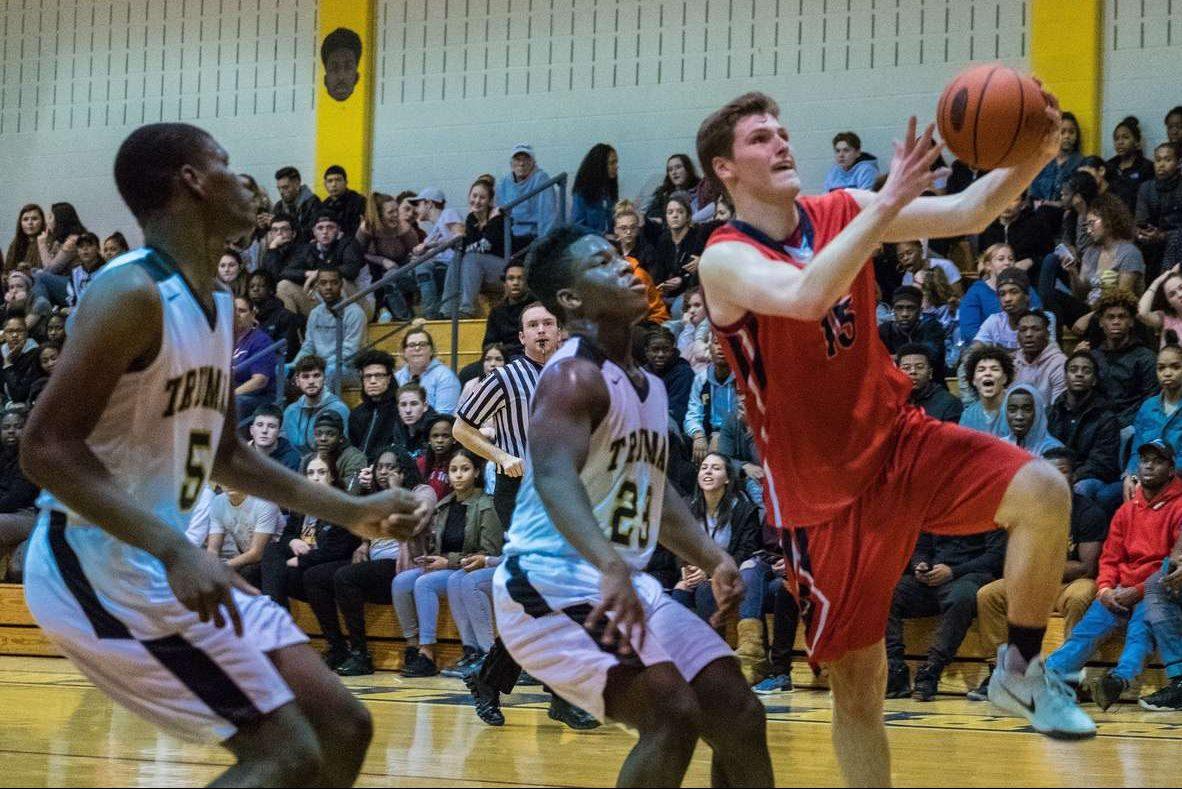 Neshaminy senior guard Chris Arcidiacono (15) drives to the basket against Harry S Truman.