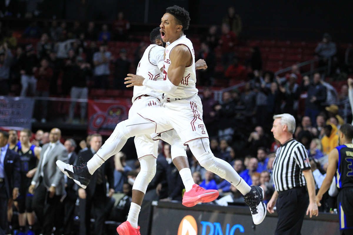 Josh Brown, left, and Nate Pierre-Louis of Temple celebrate after their 59-58 victory over Tulsa at the Liacouras Center on Wednesday.