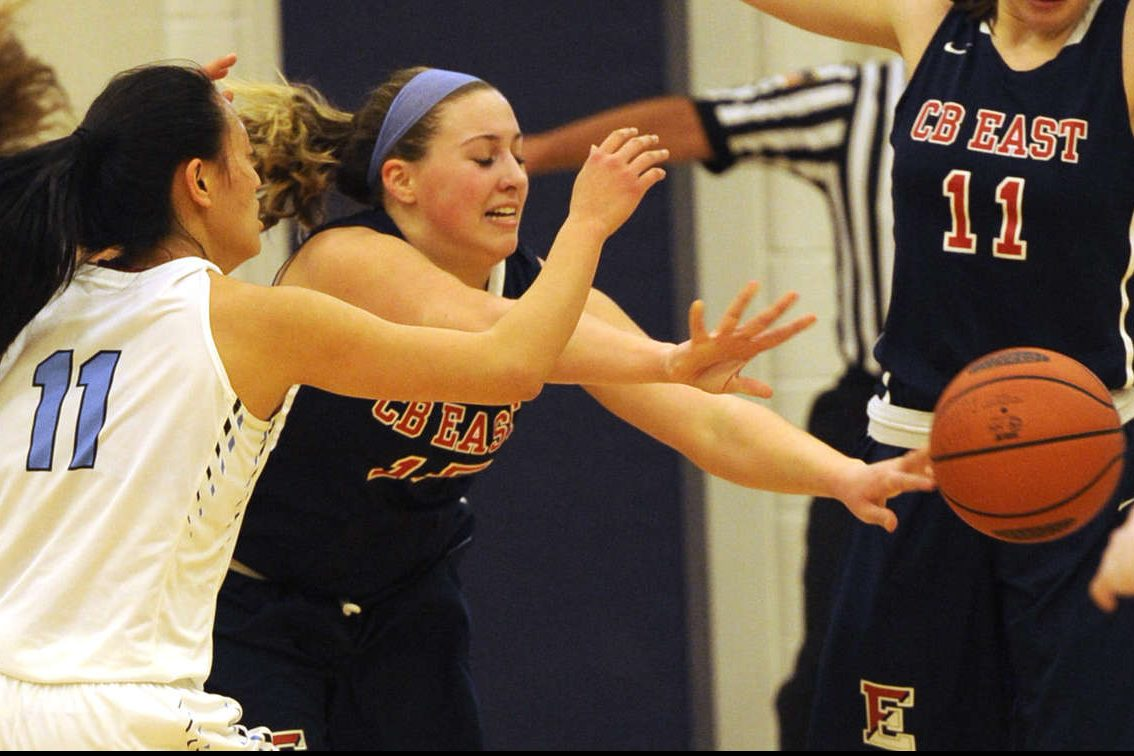 Central Bucks East Gina Russo, right, drives past North Penn's Irsia Ye, left, last season.C.B. East topped Council Rock South, 71-39, on Wednesday.