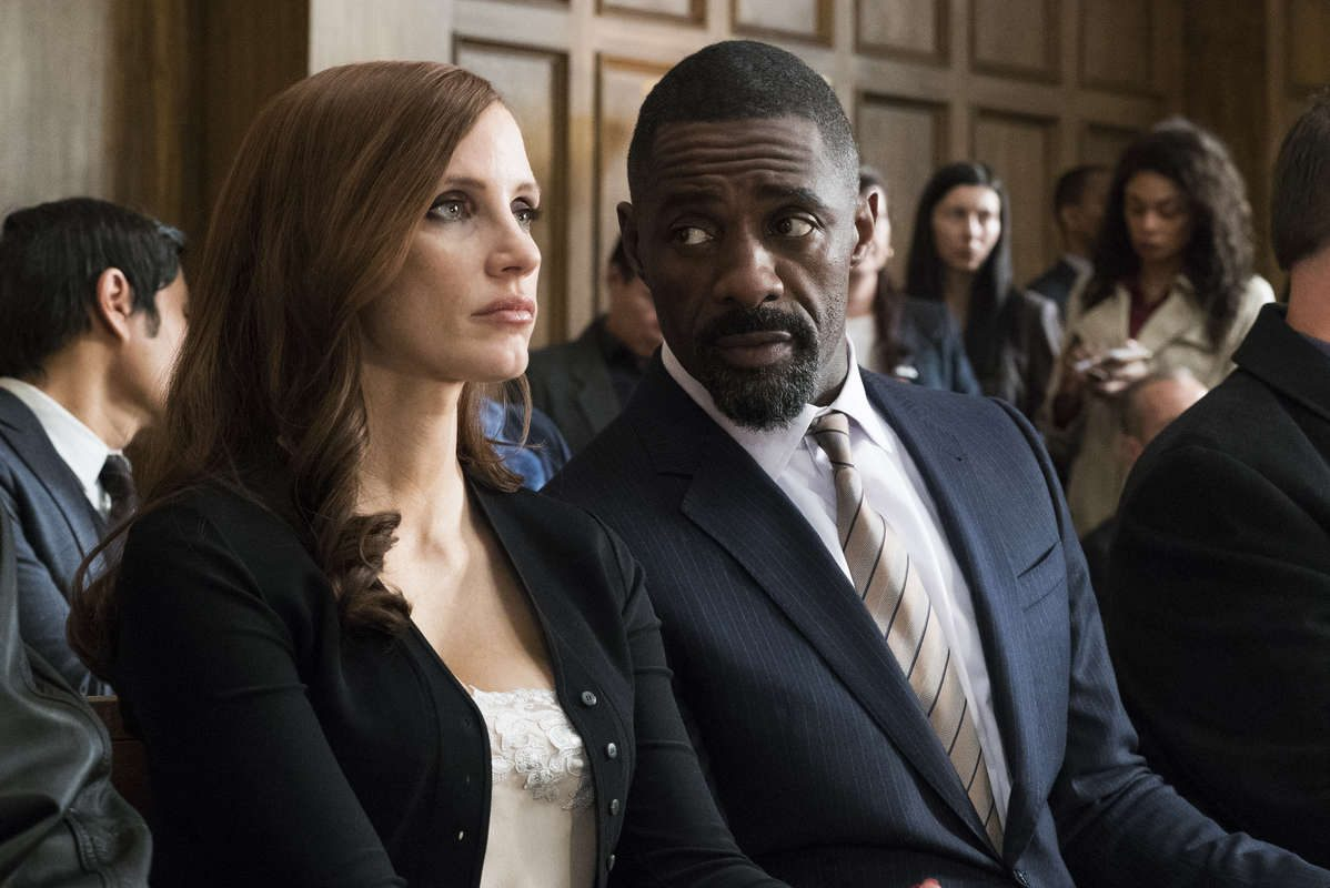 "Jessica Chastain and Idris Elba and  in ""Molly's Game."""