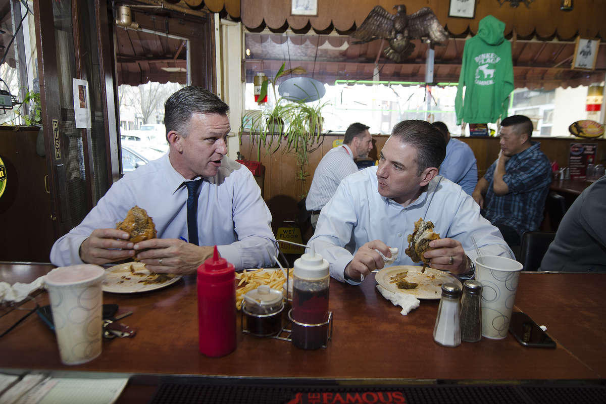Matt Ridgway of Cinnaminson, N.J., left, and Chris Bradley, of Berwyn, Pennsylvania, eat cheesesteaks during lunch time at Donkey´s Place in Camden, N.J. The bar-restaurant has been doing its thing near downtown Camden for more than 70 years.