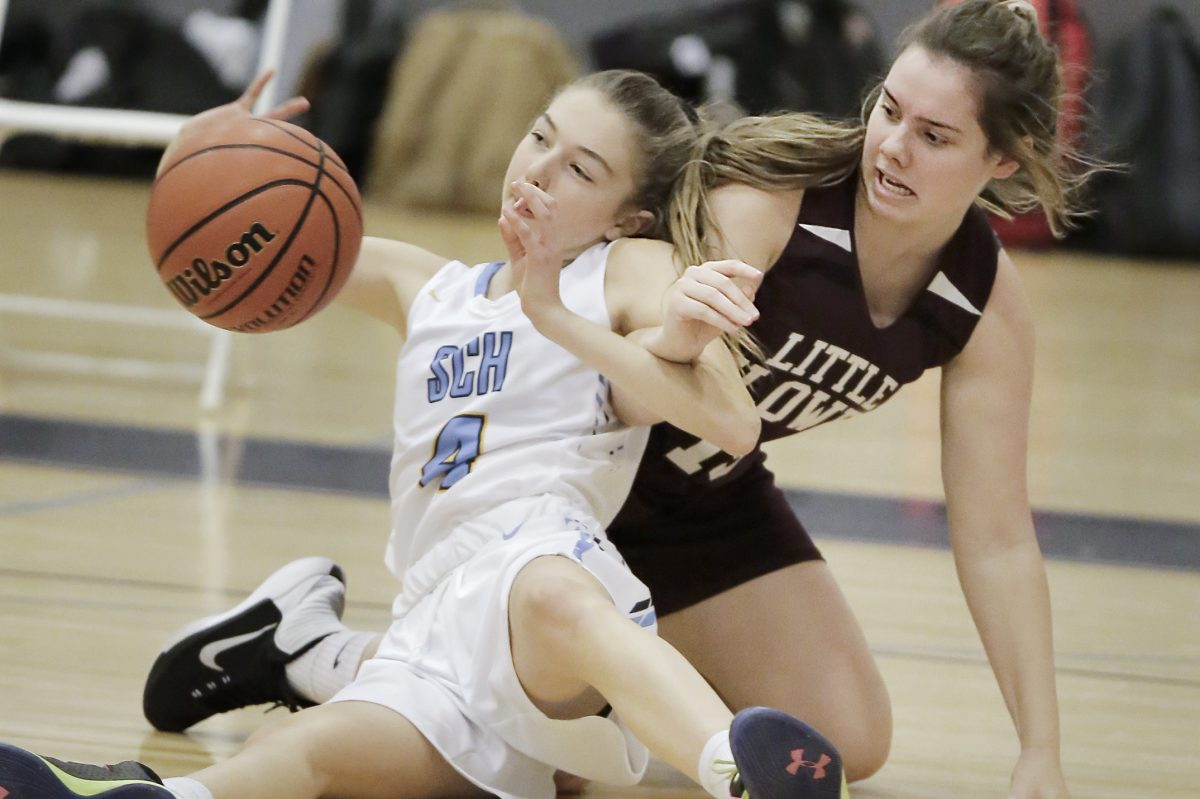 Springside Chestnut Hill Academy's Moira Mulligan (left) and Little Flower's Meg Trasser battle for a loose ball.