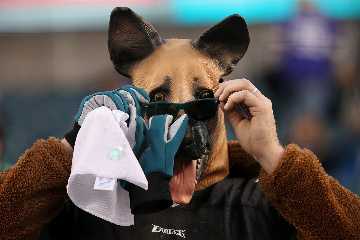 An Eagles fan puts on sunglasses over an underdog mask before the NFC Championship game at Lincoln Financial Field on Sunday.
