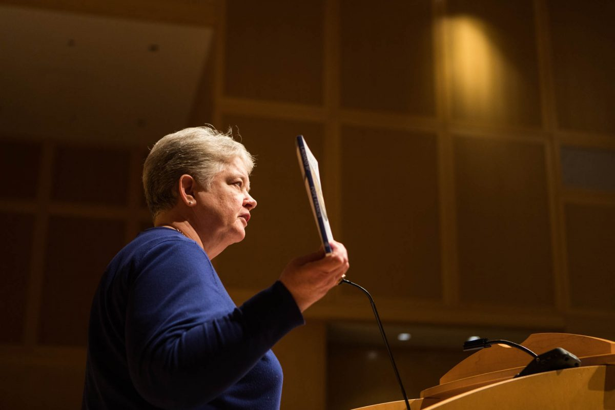 "Sister Janet McCann of the Adorers of the Blood of Christ holds up the Pope Francis encyclical ""Laudato Si"" while addressing attendees at the National Constitution Center on Friday, January 19, 2018.  The nuns have filed a religious freedom suit against the federal government and owners of a pipeline on their property."