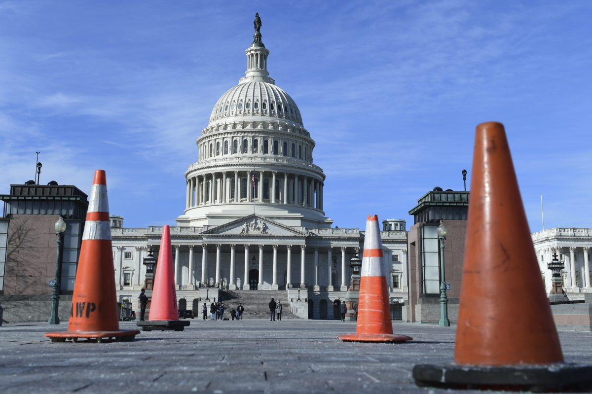 Construction cones used to cover walkway flaws, stand along the sidewalk on Capitol Hill in Washington, Friday, Jan. 19, 2018. On the edge of a government shutdown, a divided House voted late Thursday to keep the government open past a Friday deadline — setting up an eleventh-hour standoff in the Senate, where Democrats have vowed to kill the measure.
