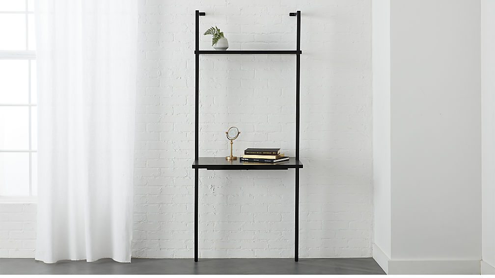 A stairway black 72.5-inch desk at CB2 retails for $349. The high-end furniture store debuts on 1422-24 Walnut Street on Feb. 2.