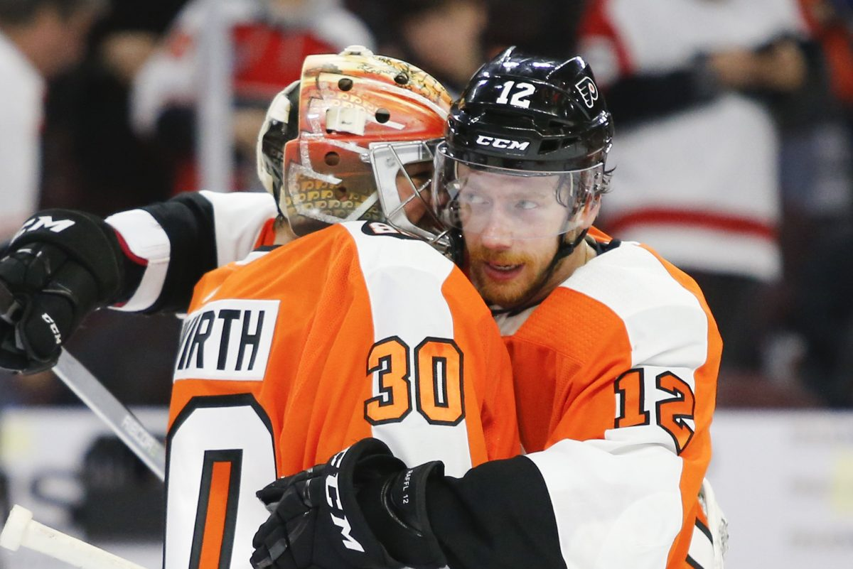 Flyers goaltender Michal Neuvirth is congratulated by Michael Raffl after beating the Toronto Maple Leafs in overtime on Thursday.