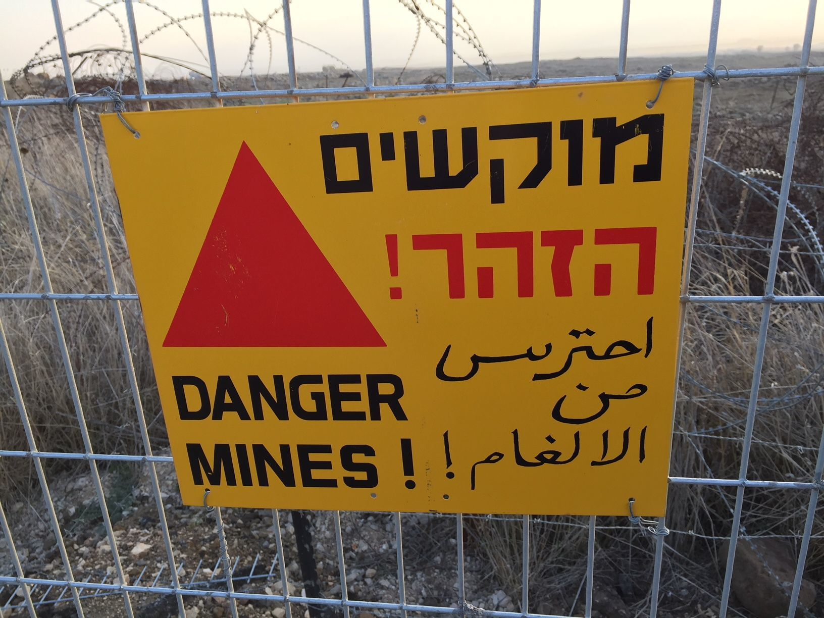 Sign on Israeli border with Syria warning not to cross.