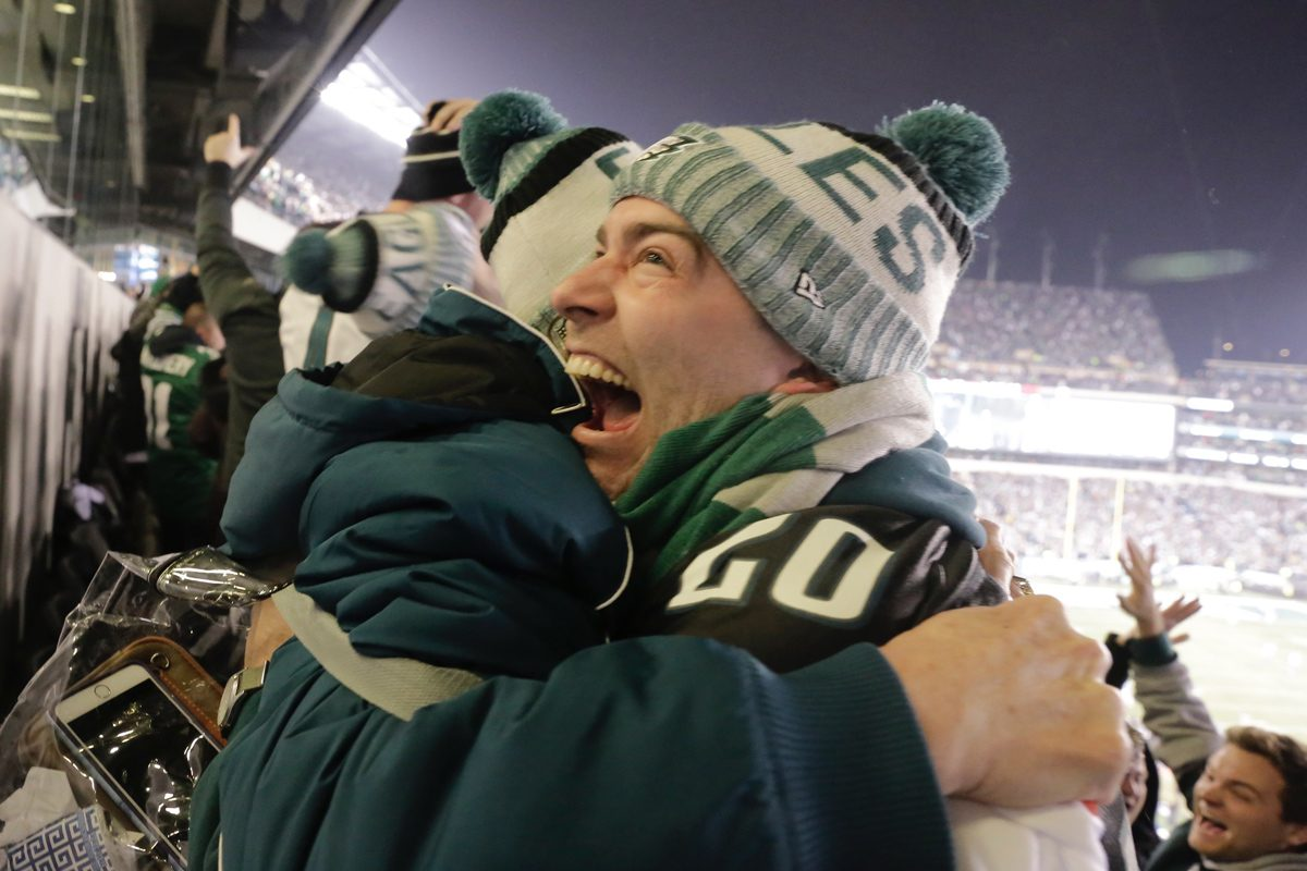 Billy Bohling of Hoboken hugs his mom, Jennifer Bohling, as they wildly celebrate an Eagles touchdown against the Vikings during the NFC championship game at Lincoln Financial Field.