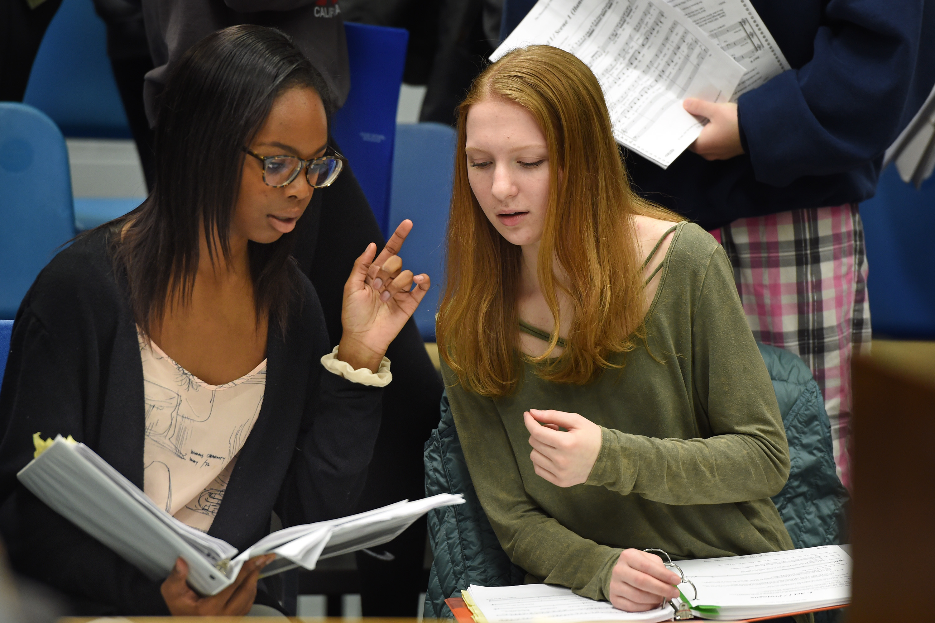 Cherry Hill High School West students Shania Walcott (left) and Jenna Hopkins (right) singing as Christine Daae (there are two casts) talk about the music as they rehearse their production of the Phantom of the Opera January 23, 2018. The arts are big in Cherry Hill where the district´s two high schools put on elaborate productions twice a year. Across the region, arts programs have struggled in some public schools in lean economic times. Schools have had to get creative in fundraising or turn to parents. TOM GRALISH / Staff Photographer