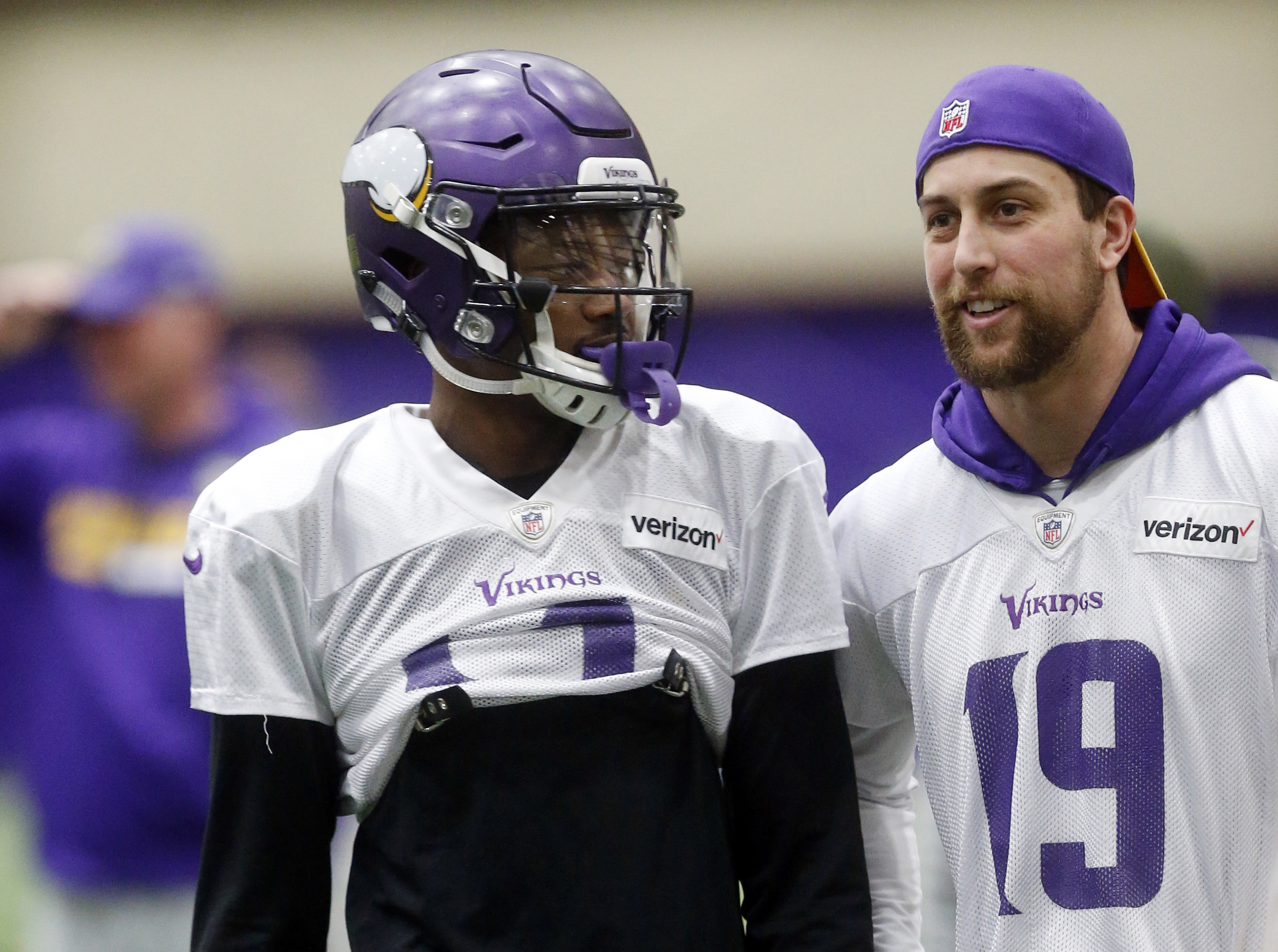 Vikings wide receiver Stefon Diggs, left, chats with fellow wide receiver Adam Thielen during practice Wednesday.