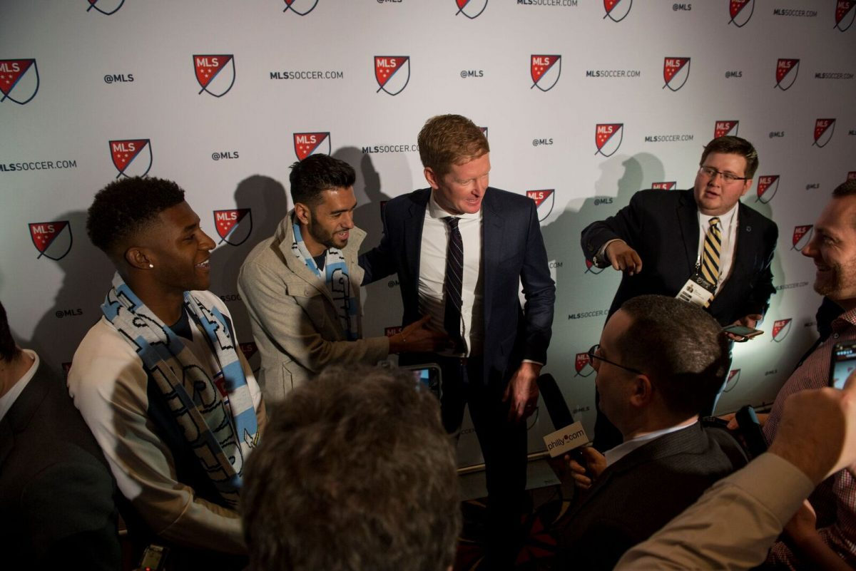Philadelphia Union manager Jim Curtin (center) with new signings Matthew Real (next to Curtin) and Mark McKenzie (far left) at the 2018 Major League Soccer SuperDraft.