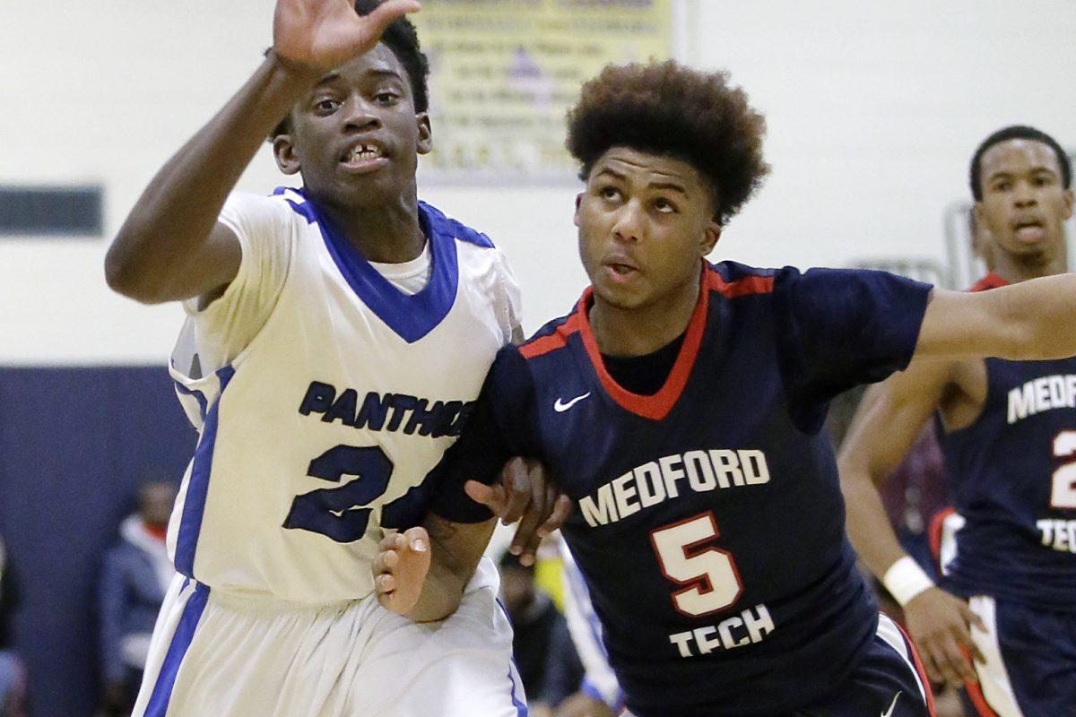 Westampton Tech's Manny Jeh (left) and Medford Tech's Terrell Martinez-Jones battle for a loose ball in the 3rd quarter of the Medford Tech at Westampton Tech boys basketball game on January 6, 2017. Westampton won the game in overtime 78-76.