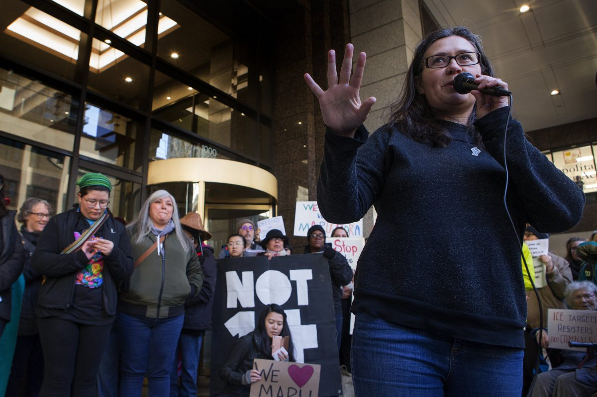 Maru Mora Villalpando, a well-known immigrant activist, herself an undocumented person who has been put in deportation proceedings, speaks to a crowd during a press conference on Tuesday, January 16, 2018 in front of the ICE office in downtown Seattle, Wash.